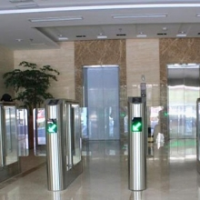 Office building lobby swing gate system